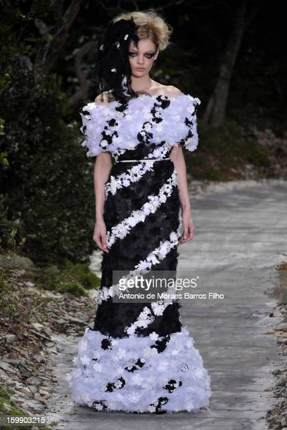 Model walks the runway during the Chanel Spring/Summer 2013 Haute-Couture show as part of Paris Fashion Week at Grand Palais on January 22, 2013 in...