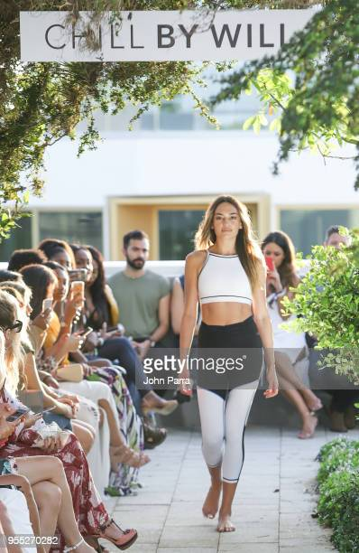 A model walks the runway during the Chill By Will Fashion Show At The Retreat on May 5 2018 in Miami Florida