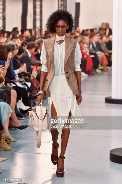 A model walks the runway during the Chloe Ready to Wear Spring/Summer 2020 fashion show as part of Paris Fashion Week on September 26 2019 in Paris...