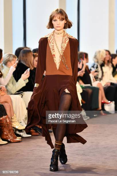 A model walks the runway during the Chloe show as part of the Paris Fashion Week Womenswear Fall/Winter 2018/2019 on March 1 2018 in Paris France
