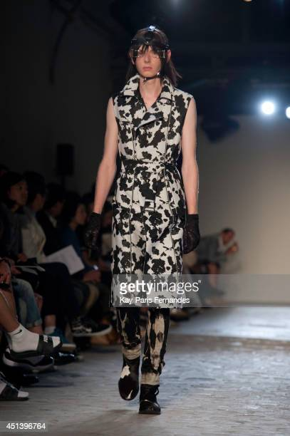 A model walks the runway during the Christian Dada show as part of the Paris Fashion Week Menswear Spring/Summer 2015 on June 28 2014 in Paris France