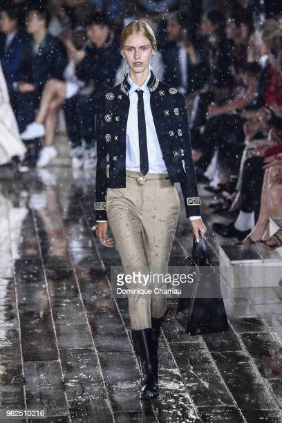A model walks the runway during the Christian Dior Couture S/S19 Cruise Collection At Grandes Ecuries De Chantilly on May 25 2018 in Chantilly France