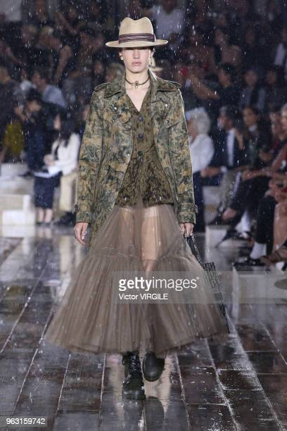 A model walks the runway during the Christian Dior Couture S/S19 Cruise Collection on May 25 2018 in Chantilly France