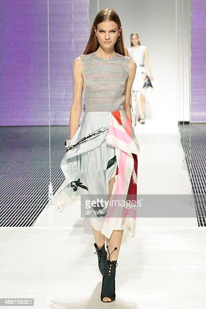 A model walks the runway during the Christian Dior Cruise 2015 show at Brooklyn Navy Yard on May 7 2014 in the Brooklyn borough of Brooklyn New York