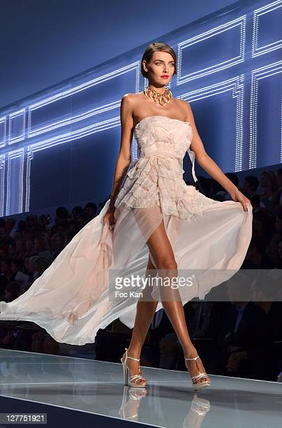 Model walks the runway during the Christian Dior Ready to Wear Spring/Summer 2012 show during Paris Fashion Week at Musee Rodin on September 30, 2011...