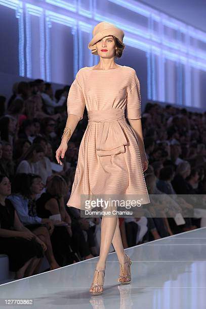 Model walks the runway during the Christian Dior Ready to Wear Spring / Summer 2012 show during Paris Fashion Week at Musee Rodin on September 30,...