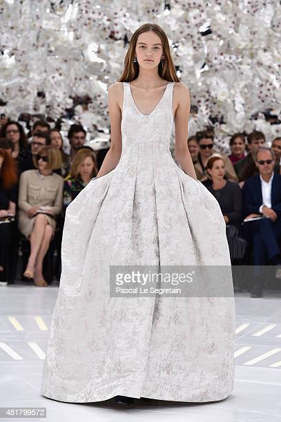 A model walks the runway during the Christian Dior show as part of Paris Fashion Week Haute Couture Fall/Winter 20142015 on July 7 2014 in Paris...