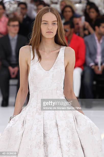 A model walks the runway during the Christian Dior show as part of Paris Fashion Week Haute Couture Fall/Winter 20142015 at on July 7 2014 in Paris...