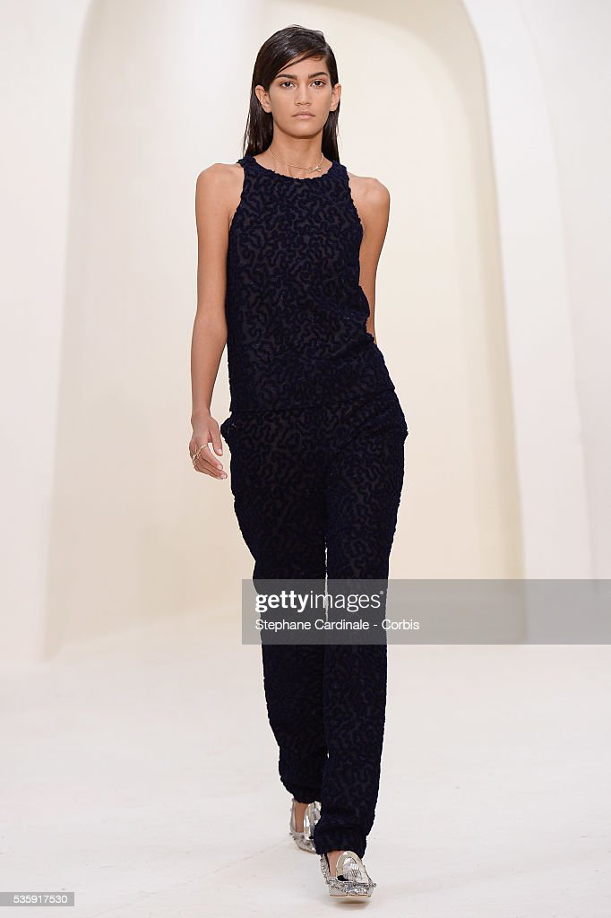 A model walks the runway during the Christian Dior show as part of Paris Fashion Week Haute Couture Spring/Summer 2014, in Paris.