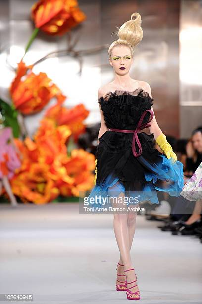 A model walks the runway during the Christian Dior show as part of the Paris Haute Couture Fashion Week Fall/Winter 2011 at Musee Rodin on July 5...