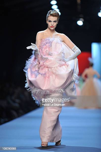 A model walks the runway during the Christian Dior show as part of the Paris Haute Couture Fashion Week Spring/Summer 2011 at Musee Rodin on January...