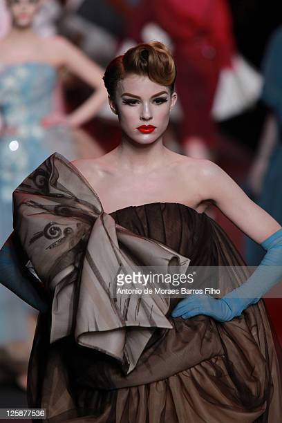 bf13ef1375 A model walks the runway during the Christian Dior show as part of the Paris  Haute