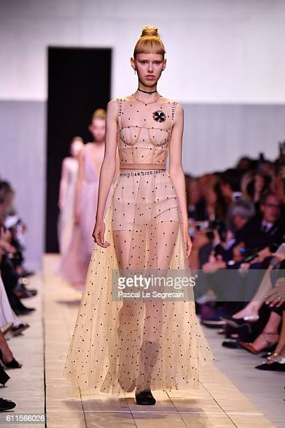 A model walks the runway during the Christian Dior show as part of the Paris Fashion Week Womenswear Spring/Summer 2017 on September 30 2016 in Paris...
