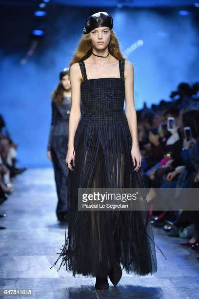 A model walks the runway during the Christian Dior show as part of the Paris Fashion Week Womenswear Fall/Winter 2017/2018 at Musee Rodin on March 3...
