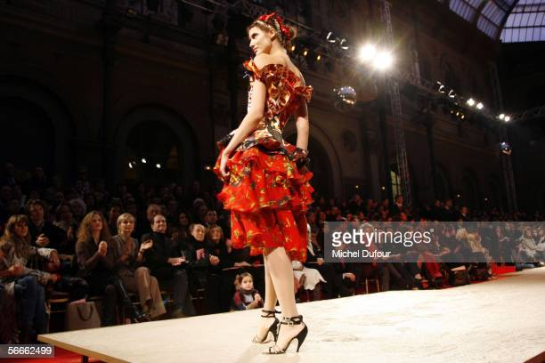 A model walks the runway during the Christian Lacroix fashion show as part of Paris Fashion Week Spring/Summer 2006 January 24 2006 in Paris France