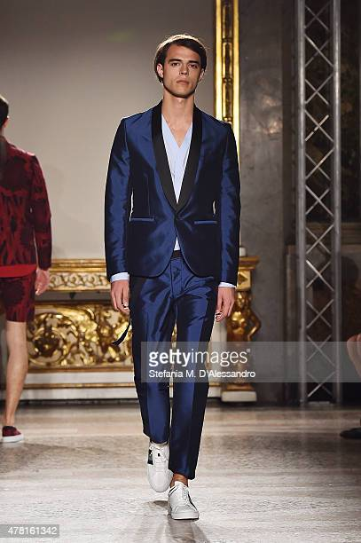 A model walks the runway during the Christian Pellizzari fashion show as part of Milan Men's Fashion Week Spring/Summer 2016 on June 23 2015 in Milan...