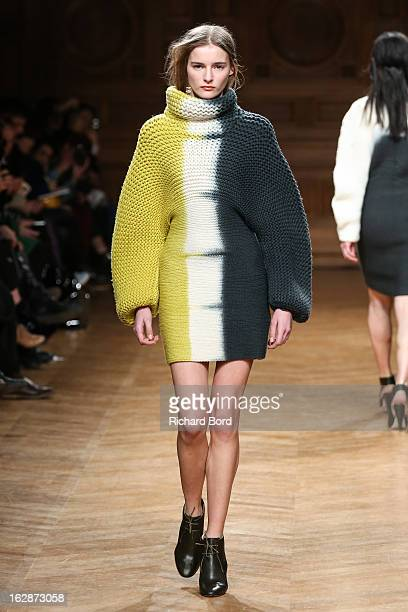 Model walks the runway during the Christian Wijnants Fall/Winter 2013 Ready-to-Wear show as part of Paris Fashion Week on February 28, 2013 in Paris,...