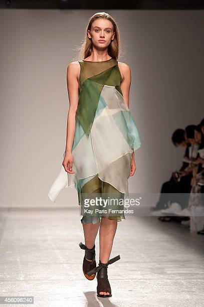 Model walks the runway during the Christian Wijnants show as part of the Paris Fashion Week Womenswear Spring/Summer 2015 on September 25, 2014 in...