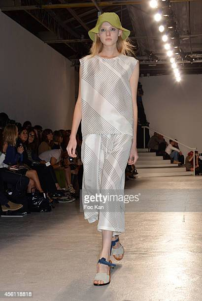 Model walks the runway during The Christian Wijnants show as part of the Paris Fashion Week Womenswear Spring/Summer 2015 at the Palais de Tokyo on...