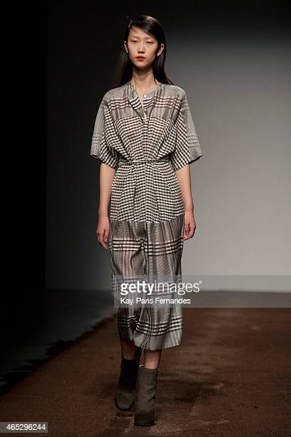 A model walks the runway during the Christian Wijnants show as part of the Paris Fashion Week Womenswear Fall/Winter 2015/2016 on March 5 2015 in...