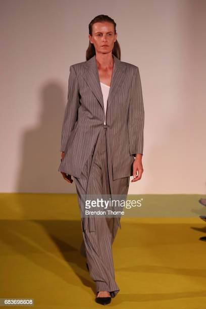 A model walks the runway during the Christopher Esber show at MercedesBenz Fashion Week Resort 18 Collections at The Clothing Store on May 16 2017 in...