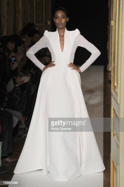 A model walks the runway during the Clarisse Hieraix Spring/Summer 2013 HauteCouture show as part of Paris Fashion Week at the ShangriLa Hotel Paris...