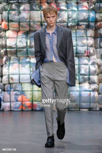 Fashion fashion designers Saif Bakir and Emma Hedlund acknowledge the audience at the end of their men's spring/summer 2019 collection fashion for...