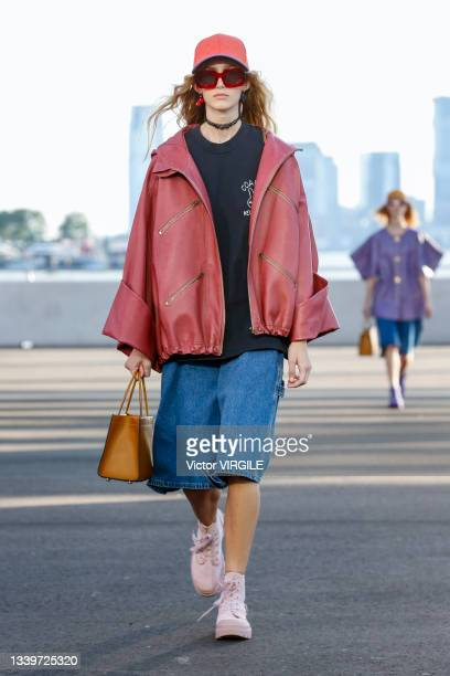 Model walks the runway during the Coach Ready to Wear Spring/Summer 2022 fashion show as part of the New york Fashion Week on September 10, 2021 in...