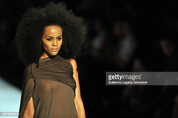 A model walks the runway during the Colombian designer Carolina Sepulveda show as part of second day of Cali Exposhow 2014 Fashion Week on October 15...