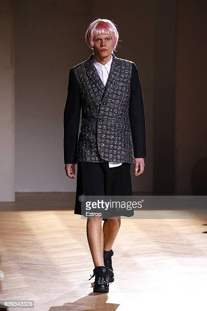 A model walks the runway during the Comme Des Garcons Homme Plus Menswear Fall/Winter 20172018 show as part of Paris Fashion Week on January 20 2017...
