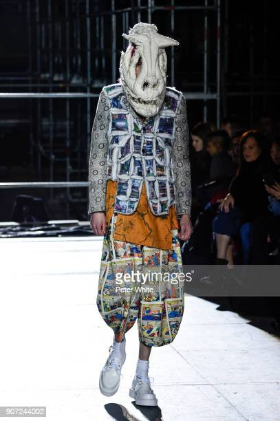 Model walks the runway during the Comme Des Garcons Homme Plus Menswear Fall/Winter 2018-2019 show as part of Paris Fashion Week on January 19, 2018...