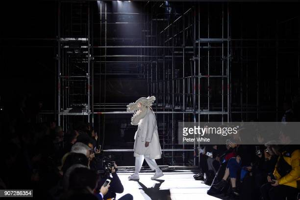 A model walks the runway during the Comme Des Garcons Homme Plus Menswear Fall/Winter 20182019 show as part of Paris Fashion Week on January 19 2018...