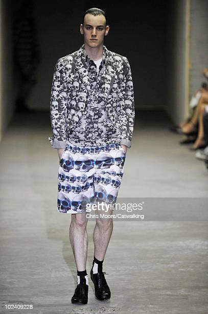 Model walks the runway during the Comme Des Garcons Hommes Plus fashion show at Paris Menswear Fashion Week for Spring Summer 2011 on June 25, 2010...