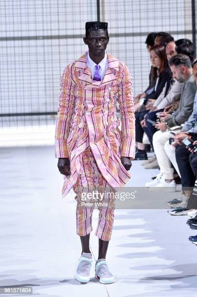 A model walks the runway during the Comme des Garcons Menswear Spring/Summer 2019 show as part of Paris Fashion Week on June 22 2018 in Paris France