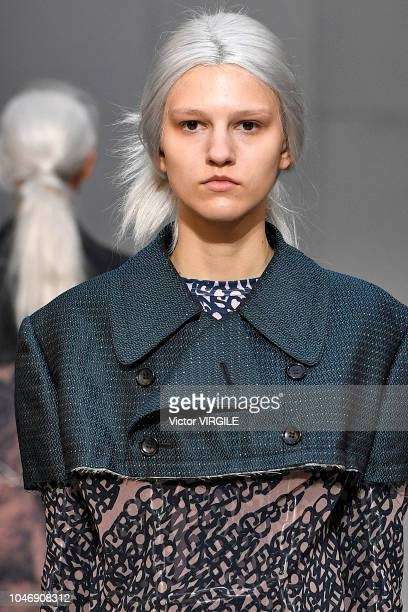 Model walks the runway during the Comme Des Garcons Ready to Wear fashion show as part of the Paris Fashion Week Womenswear Spring/Summer 2019 on...