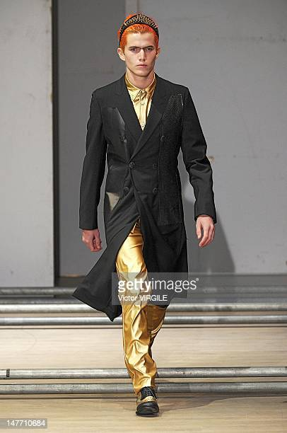 Model walks the runway during the Comme des Garcons Ready to Wear Spring/Summer 2013 show as part of the Paris Men Fashion Week on June 29, 2012 in...