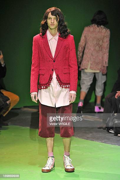 A model walks the runway during the Comme des Garcons Ready to Wear Fall/Winter 20132014 show as part of Paris Fashion Week on January 18 2013 in...