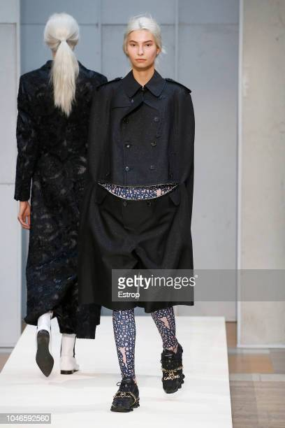 Model walks the runway during the Comme Des Garcons show as part of the Paris Fashion Week Womenswear Spring/Summer 2019 on September 29, 2018 in...