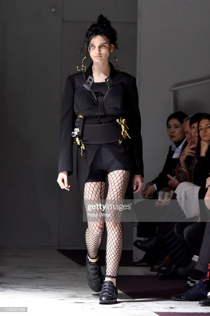 model-walks-the-runway-during-the-comme-des-garcons-show-as-part-of-picture-id1133251453