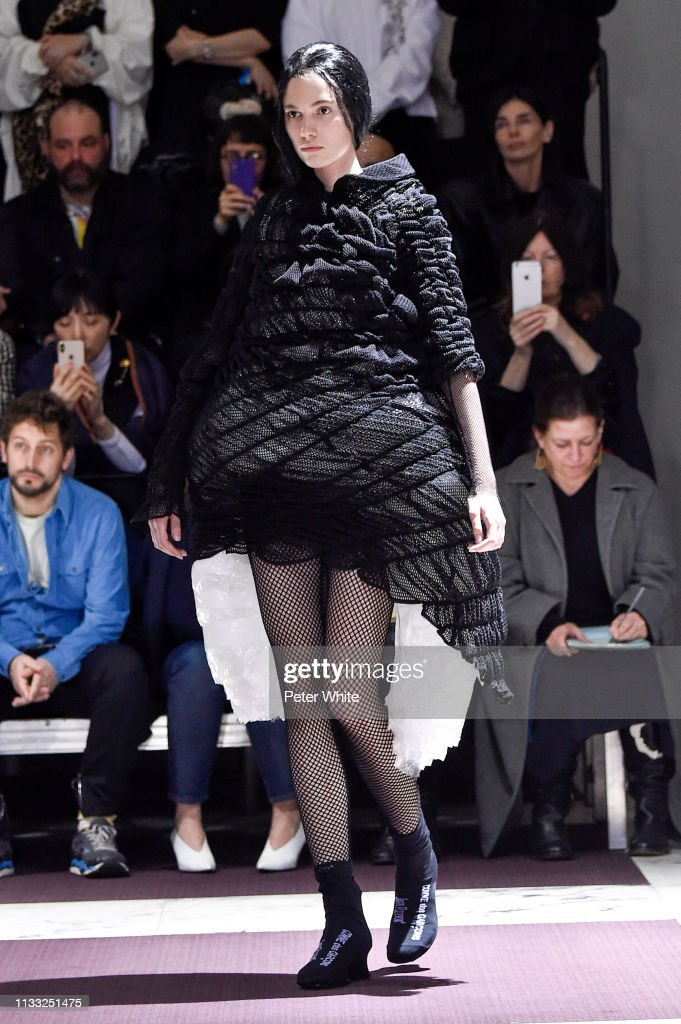 model-walks-the-runway-during-the-comme-des-garcons-show-as-part-of-picture-id1133251475
