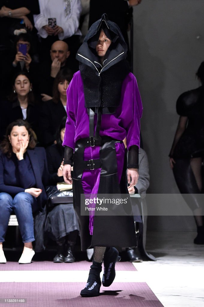 model-walks-the-runway-during-the-comme-des-garcons-show-as-part-of-picture-id1133251493