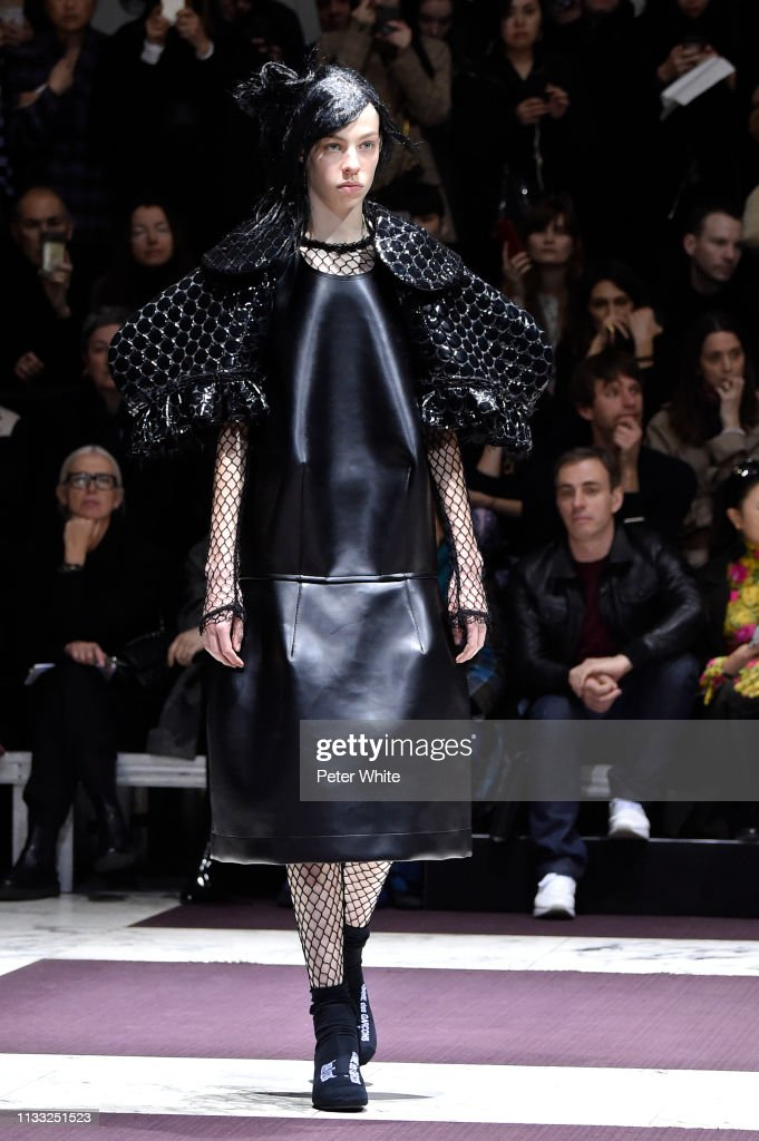 model-walks-the-runway-during-the-comme-des-garcons-show-as-part-of-picture-id1133251523