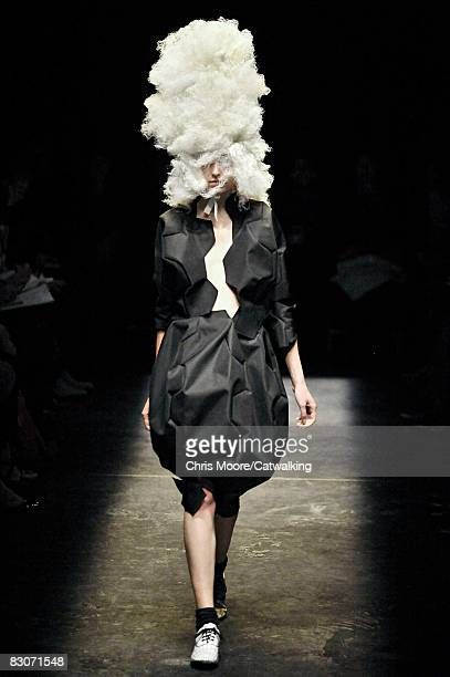 A model walks the runway during the Comme Des Garcons show part of Paris Fashion Week Spring/Summer 2009 on September 302008 in ParisFrance