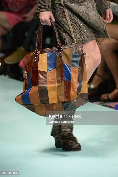 A model walks the runway during the Custo Barcelona show at the Miami Fashion Week Resort Summer 2014/2015 at Miami Beach Convention Center on May 15...