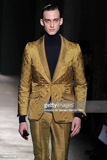 A model walks the runway during the Daks show as a part of Milan Fashion week Menswear Autumn/Winter 2013 on January 13 2013 in Milan Italy