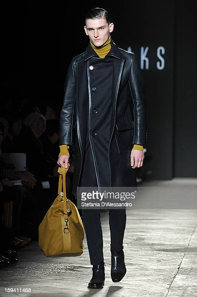 A model walks the runway during the Daks show as part of Milan Fashion Week Menswear Autumn/Winter 2013 on January 13 2013 in Milan Italy
