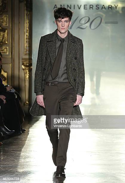 A model walks the runway during the DAKS show as part of Milan Fashion Week Menswear Autumn/Winter 2014 on January 12 2014 in Milan Italy