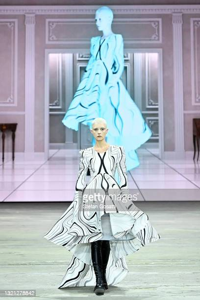 Model walks the runway during the Daniel Avakian show during Afterpay Australian Fashion Week 2021 Resort '22 Collections at Carriageworks on June...