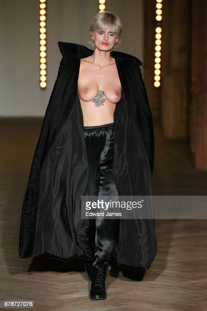 A model walks the runway during the Datuna Fall/Winter 2017/2018 collection fashion show during MercedesBenz Fashion Week Tbilisi on May 4 2017 in...