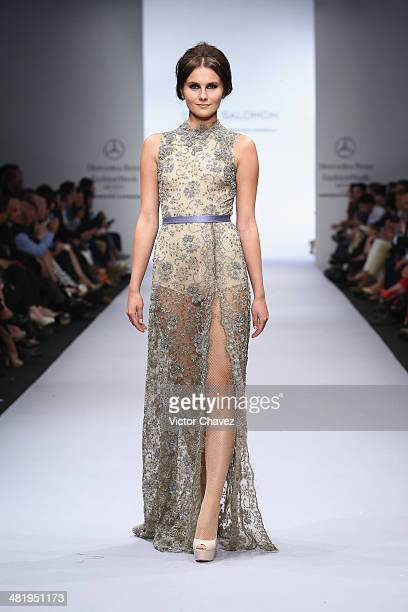 A model walks the runway during the David Saloman runway at MercedesBenz Fashion Week México Autumn/Winter 2014 at Campo Marte on April 1 2014 in...